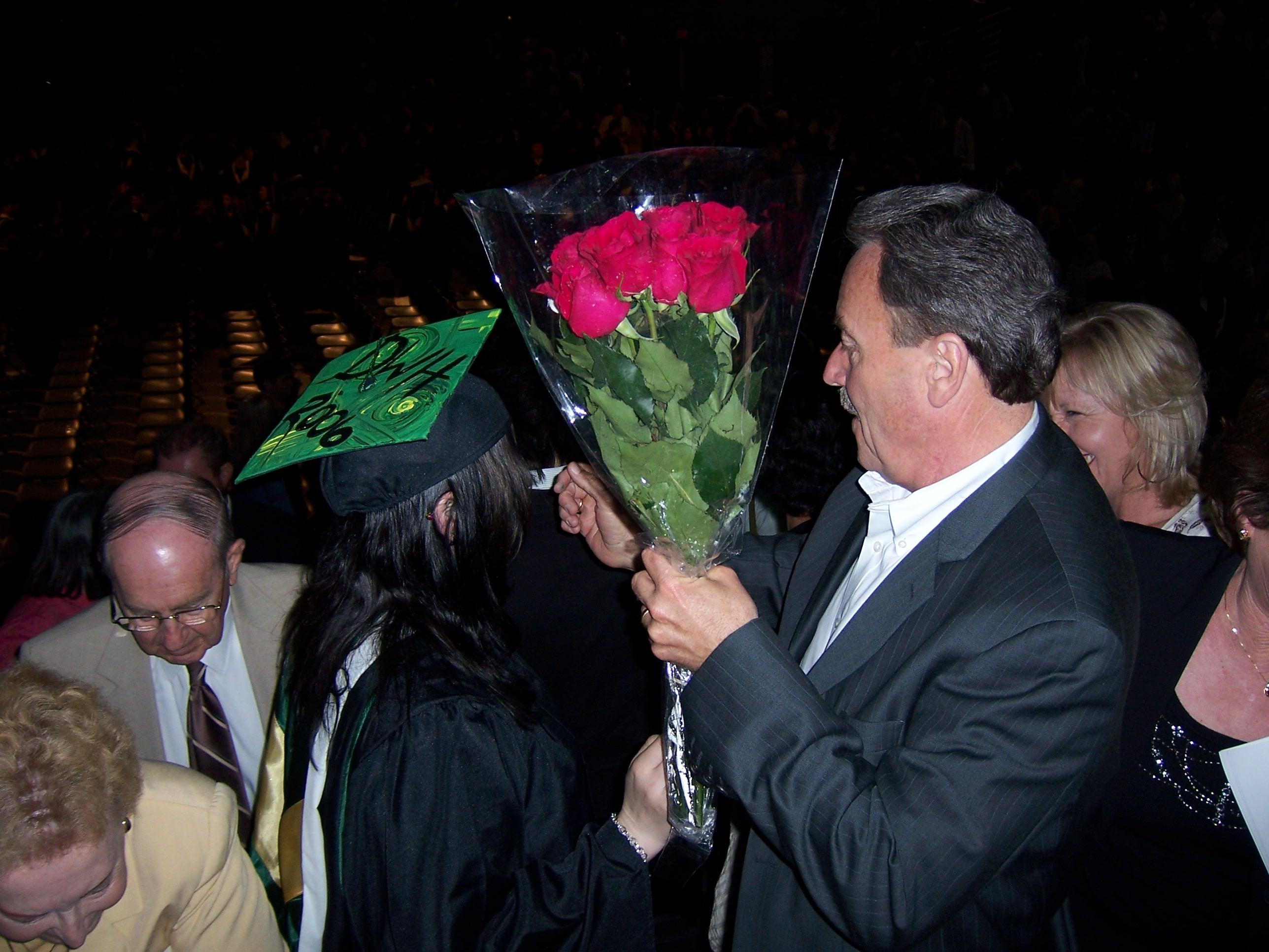 proud dad presenting roses