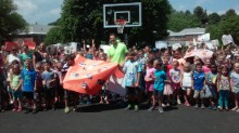 jimmer donated a basketball hoop to school