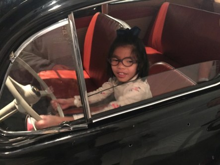 Emme driving a car in the 1950s.
