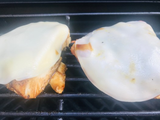 Chicken breast with melted provolone cheese.