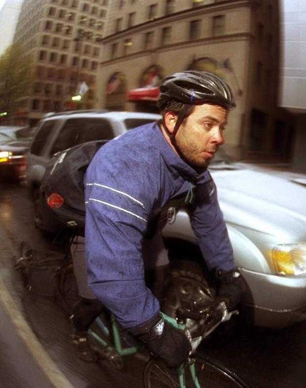 Bill Fehr Riding In Rain Uptown Charlotte (Credit: Chris Radok)