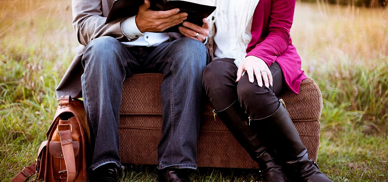 Man and woman reading book