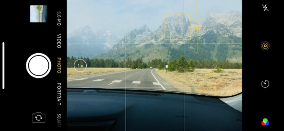 Screen capture of the Camera app with the Teton mountains in the viewfinder and the focus and brightness selector enabled.