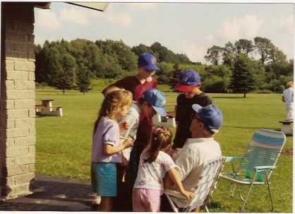 Dad surrounded by grandkids 1992