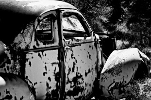 Vintage cars rust away inside the Desert Queen Ranch