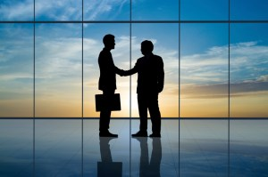 Business people handshaking.