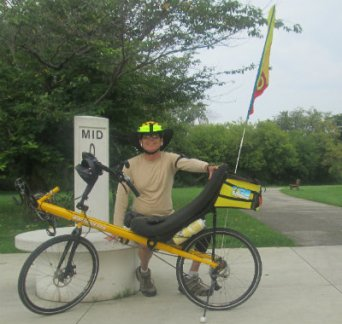 Jim-Schmid-with-Bacchetta-Giro-Recumbent-next-to-Milepost-0-sign-Pere-Marquette-MI-2015_09-06