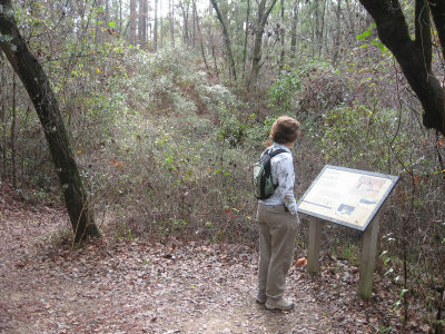 Sandra-Schmid-reading-sign-at-Leon-Sinks-Geological-Area-Tallahassee-FL-01-04-2009