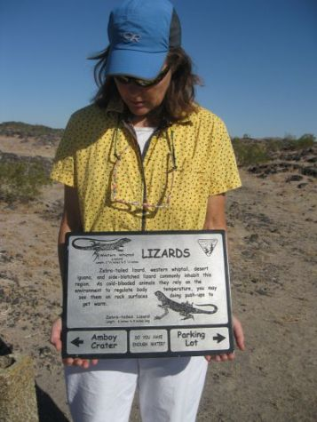 Sandra-Schmid-holding-intrepretive-sign-on-Amboy-Crater-Trail-CA-2010