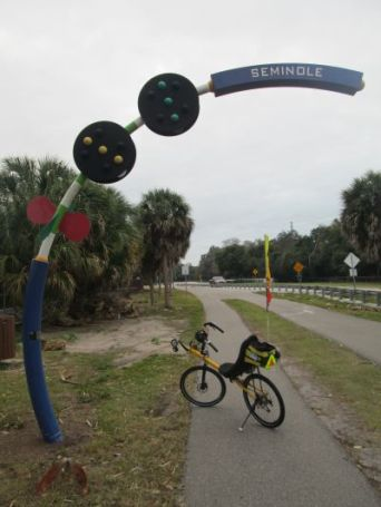 Jim-Schmid's-Bacchetta-Giro-recumbent-at-Seminole-sign-on-Pinellas-Rail-Trail-FL-1-25-2016