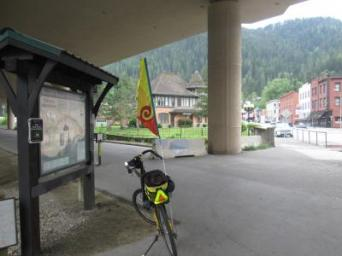 Jim-Schmid's-Bacchetta-Giro-recumbent-at-kiosk-under-freeway-Trail-of-the-Coeur-d'Alenes-Wallace-ID-5-15-2016
