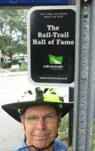 Jim-Schmid-next-to-Rail-Trail-Hall-of-Fame-sign-Minuteman-Bikeway-MA-9-5-2016