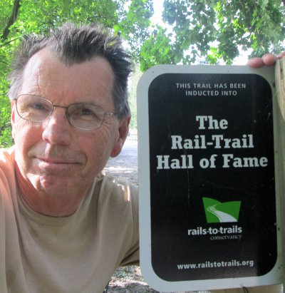 Jim-Schmid-next-to-Hall-of-Fame-sign-Torrey-C-Brown-Rail-Trail-MD-10-4-2016