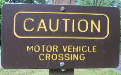 Caution_motor_vehicle_crossing_sign_Greenbrier-River-Trail-WV-06_21-24-2015