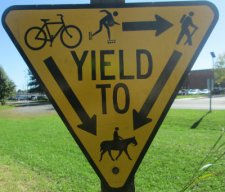 Users-yield-to-sign-W&OD-Rail-Trail-VA-2015-10-6&7