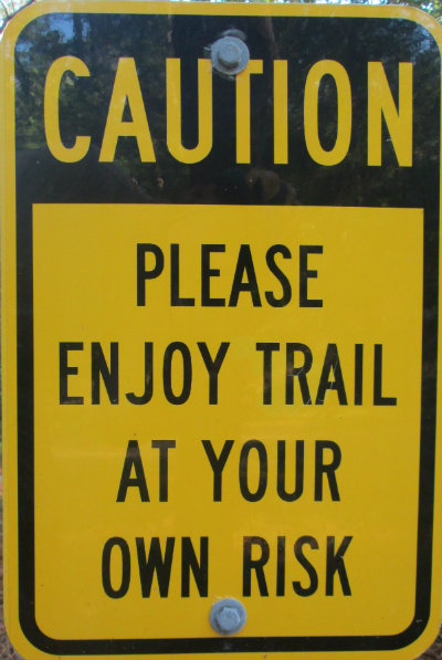 Caution-please-enjoy-trail-at-your-own-risk-sign-Longleaf-Trace-MS-2015-06-11