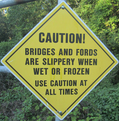 Caution-bridges-and-fords-are-slippery-when-wet-sign-W&OD-Rail-Trail-VA-2015-10-6&7