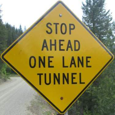One-lane-tunnel-sign-Route-of-the-Hiawatha-ID-5-26-2016