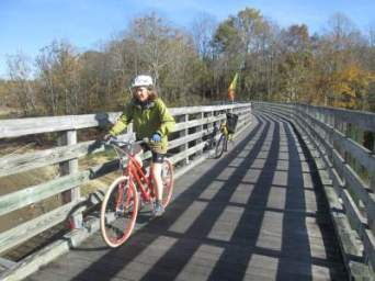 Sandra-Schmid-bicycling-on-trestle-VA-Creeper-Trail- VA-10-28-2016