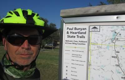 Jim-Schmid-next-to-Paul-Bunyan-Trail-sign-MN-5-14-17