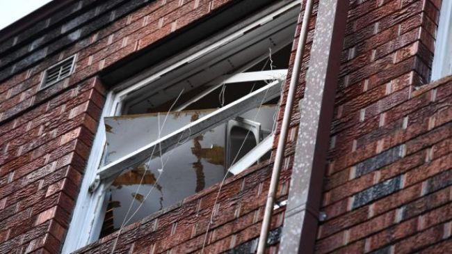 หน้าต่างยูนิตที่เกิดเหตุระเบิดของชายวัย 35 ปี : ภาพชั่วคราวจากนสพ. The SMH