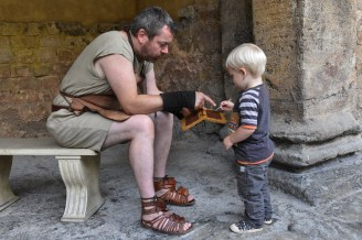 Actor of Roman Baths talking to a kid