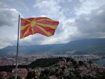The Macedonian flag has to put sun on the sky.