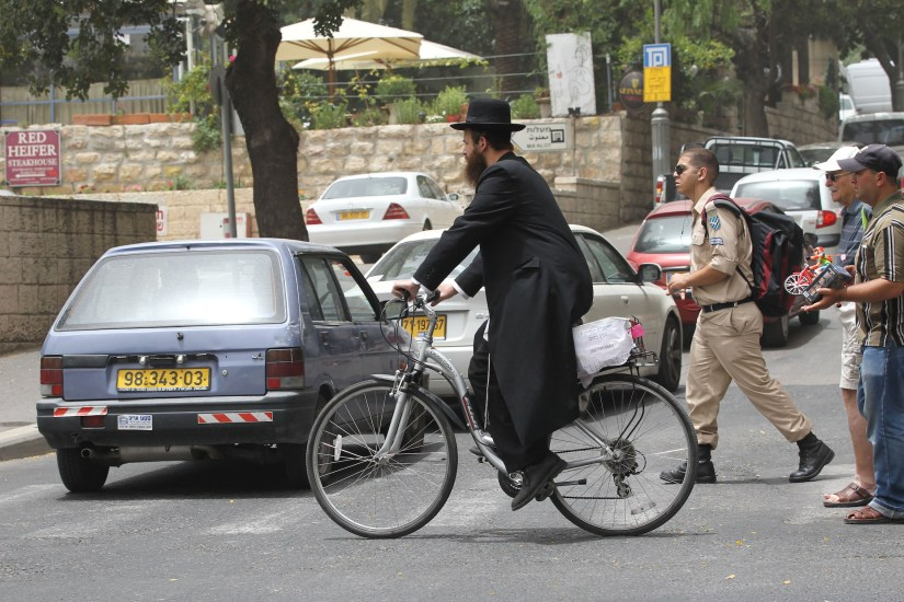 ultra orthodox jewish man riding bicycle