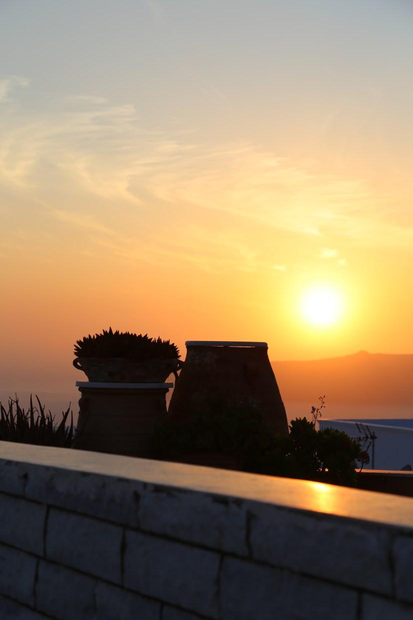 Santorini sunset with pots