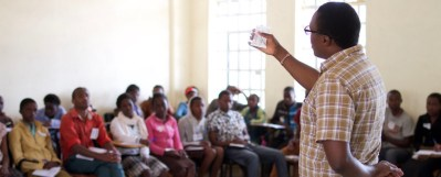 Duncan Ogendi Oginda demonstrates how to check if a female condom has expired or not.
