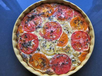 crustless Quiche, Savoury Cheese Pie, in a yellow ceramic pie dish, topped with multicolour heirloom tomatoes