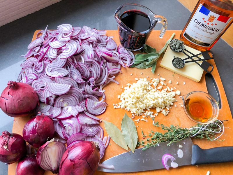 Ingredients on a cutting board for Red Onion Soup with Cheese Toasts - David Tanis Market Cooking