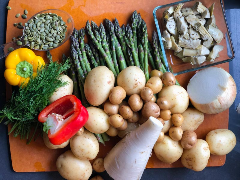 Ingredients for Julia's Summer Potato Salad: 4 - 5 lbs potatoes, perhaps Yukon Gold 1 big bunch asparagus 1/2 very large jar artichoke hearts, strained ( 16 ounces) 1/2 daikon, peeled and diced 1/2 large sweet onion, diced 1 c chopped dill 1 1/2 coloured peppers, diced 3/4 c toasted pumpkin seeds