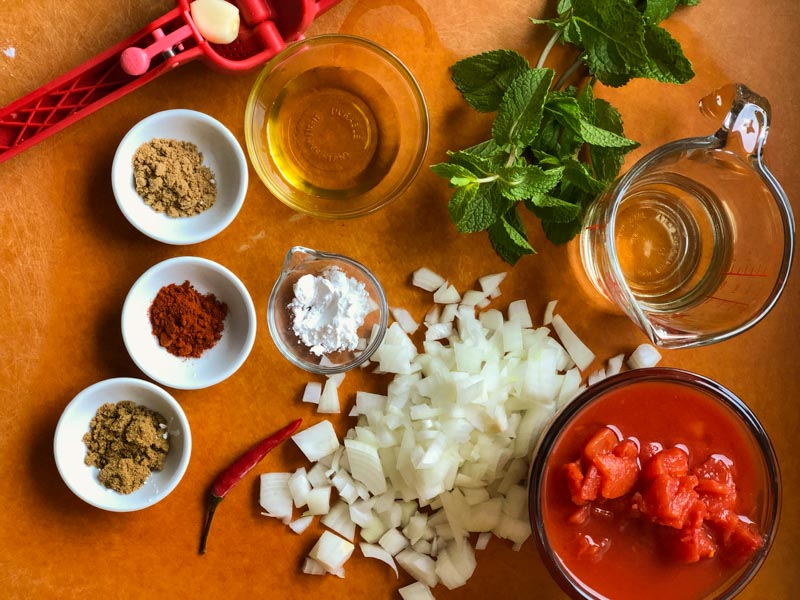 Tomato Sauce ingredients on cutting board