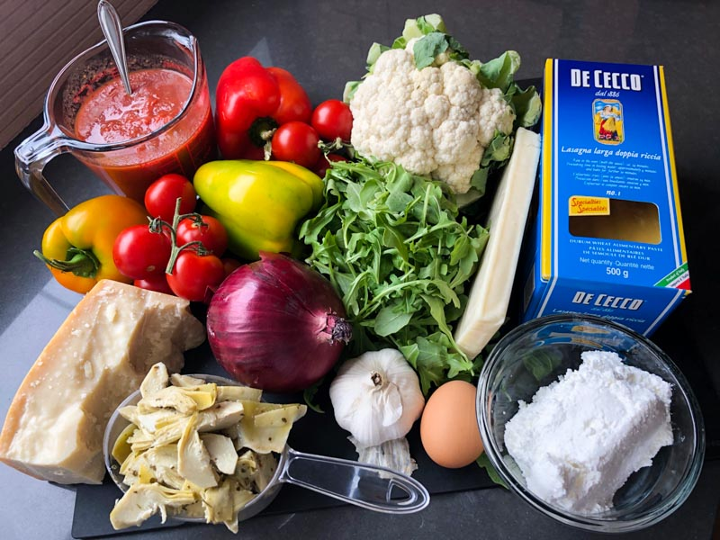 roasted veggie lasagna ingredients on a cutting board