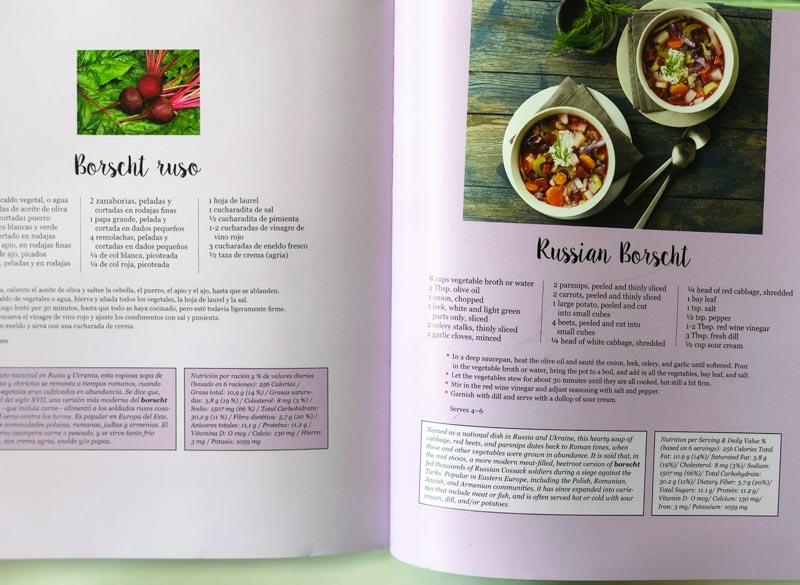 Famous Dishes From Around the World cookbook open to Russian Borscht recipe in English and Spanish