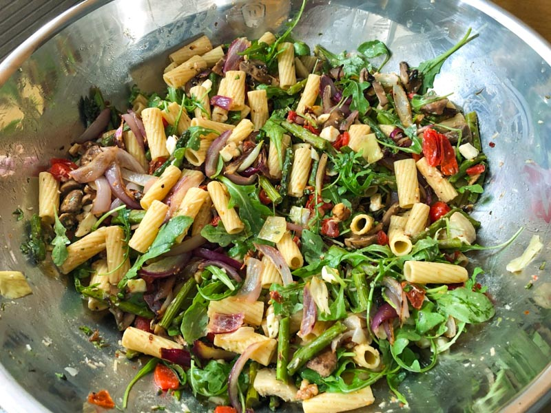Rigatoni Primavera ingredients mixed in a giant prep bowl