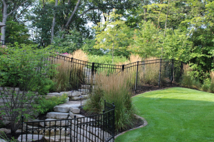 Mulching, weeding, and pruning help to keep the landscape beds attractive.