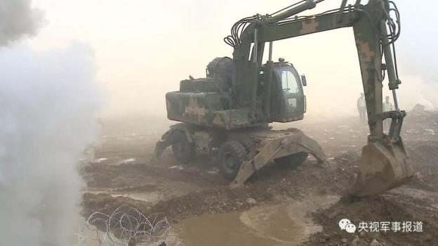 A engineering vehicle belonging to 6th Combined Arms Brigade, 82nd Group Army, Central Theater Command