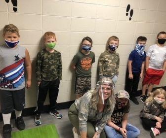 Students posing in hallway