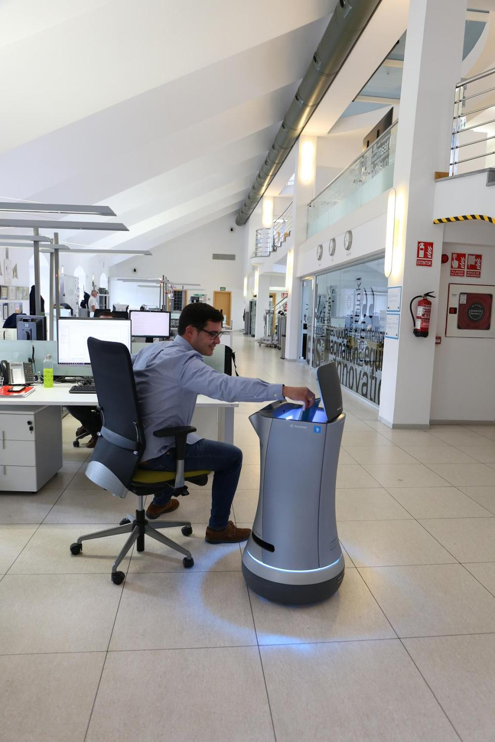 5 Robot delivering document to employee