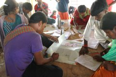 Interns working on wall newspapaper