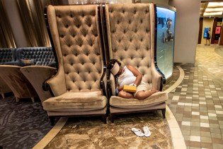 Found this woman sitting in front of the Champagne Bar. Don't think she had too much champagne, just too much Allure.