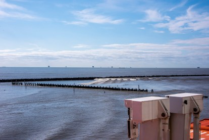 The river bank is divided up with these jetty-like areas to stop ship wakes from wearing away the banks.