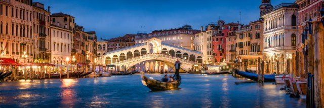 Romantic gondola ride near Rialto Bridge in Venice, Italy