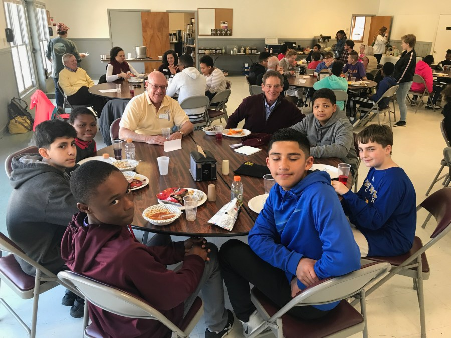 students around table having lunch