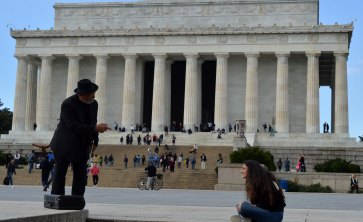 Taken by the Lincoln memorial, this guy played 'What a Wonderful World' on his trumpet as crowds gathered around to listen.