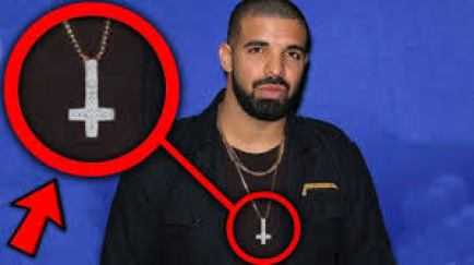 Image result for drake wearing upside down cross