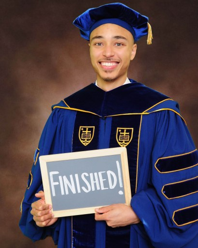 Cap and gown picture from the University of Notre Dame.