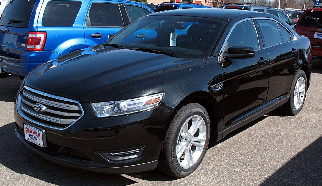 Ford recalls 2013 Ford Taurus and other models for defective right front axle.
